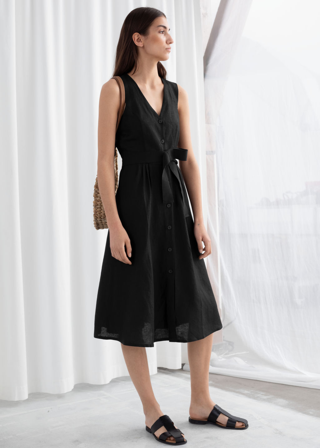 Model front image of Stories belted linen blend midi dress in black