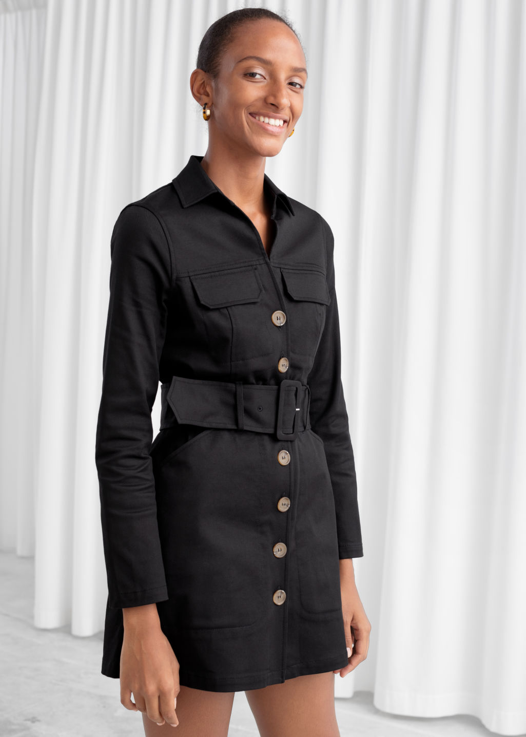 Model front image of Stories belted workwear mini dress in black