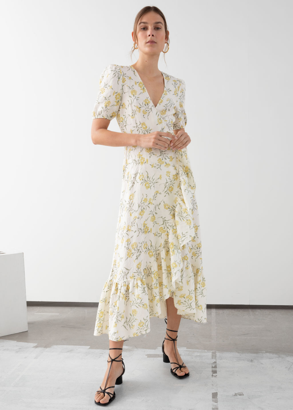 Model front image of Stories ruffled linen wrap midi dress in white