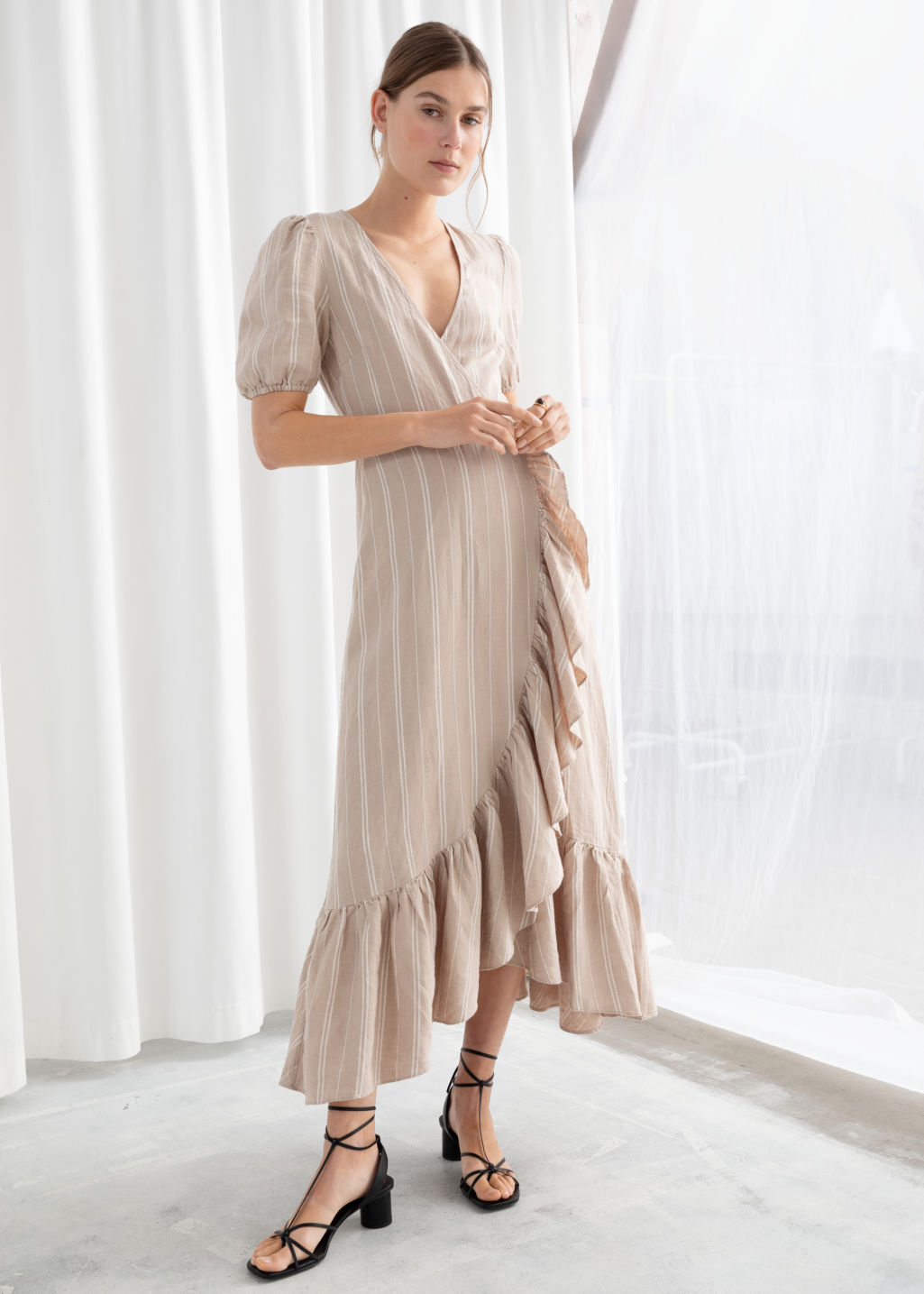 Model front image of Stories ruffled linen wrap midi dress in beige