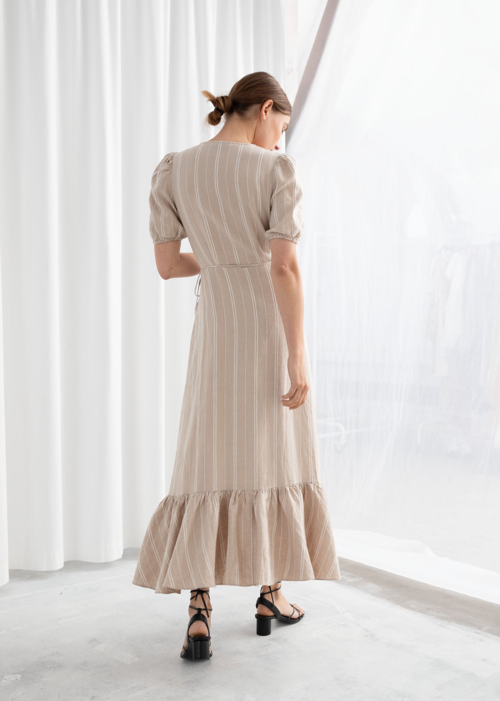 Model back image of Stories ruffled linen wrap midi dress in beige