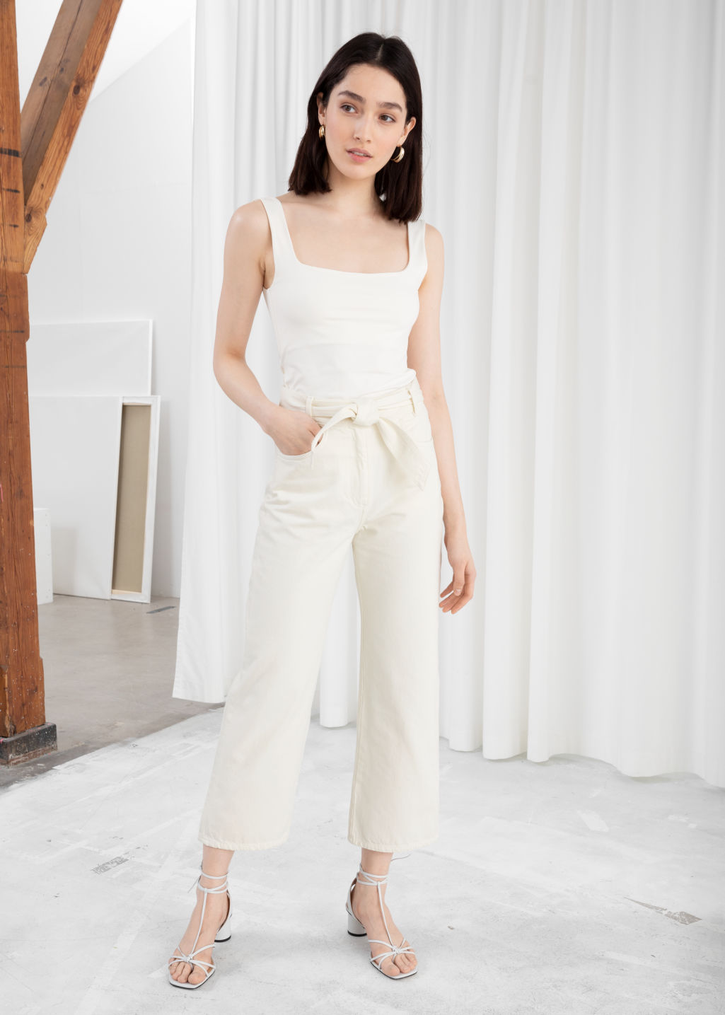 Model front image of Stories cropped high rise flare jeans in white