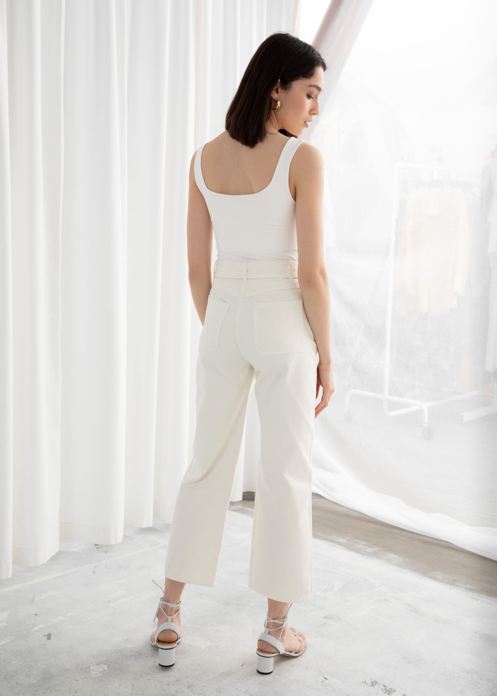 Model back image of Stories cropped high rise flare jeans in white