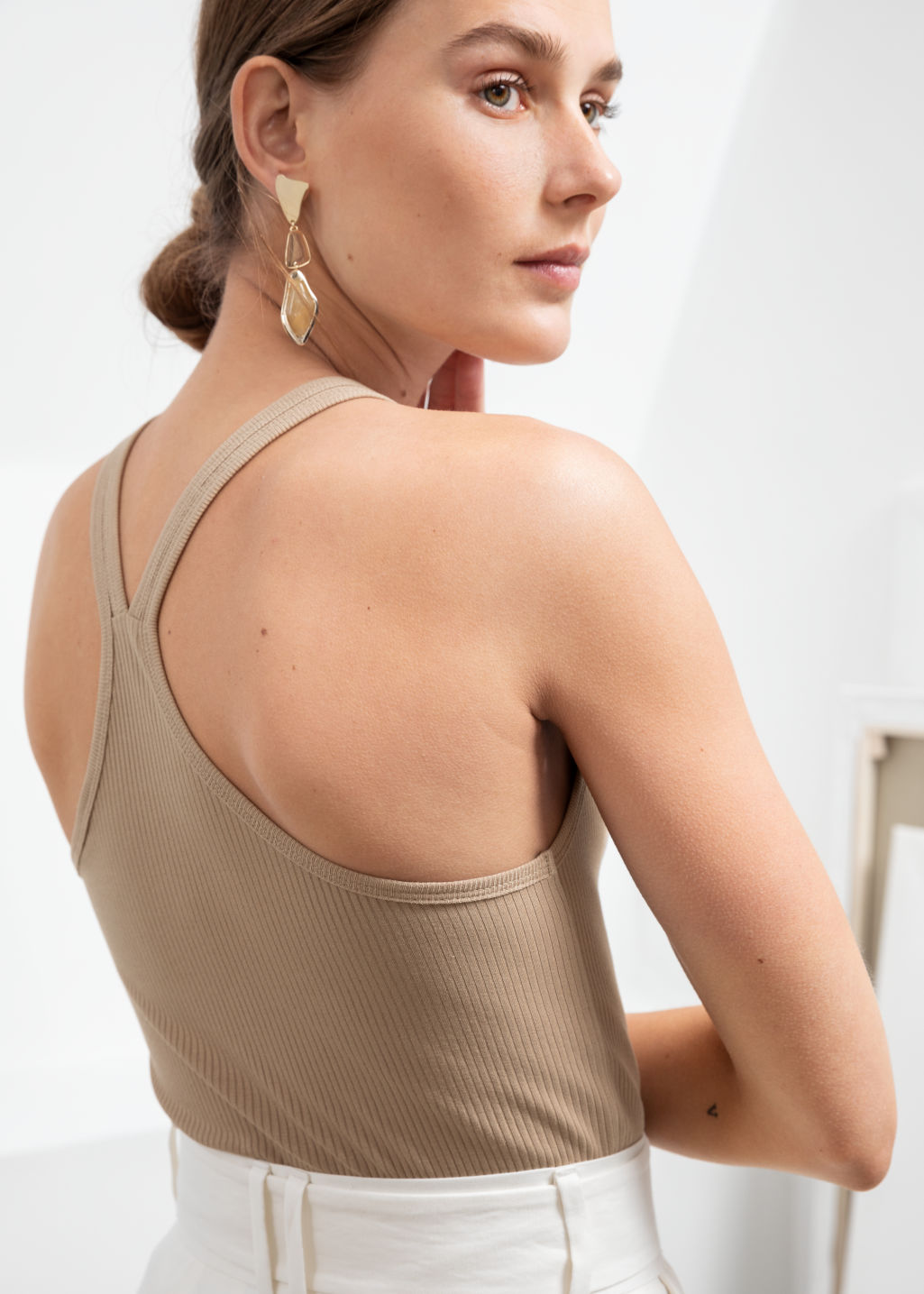 Model back image of Stories fitted racer back tank top in beige