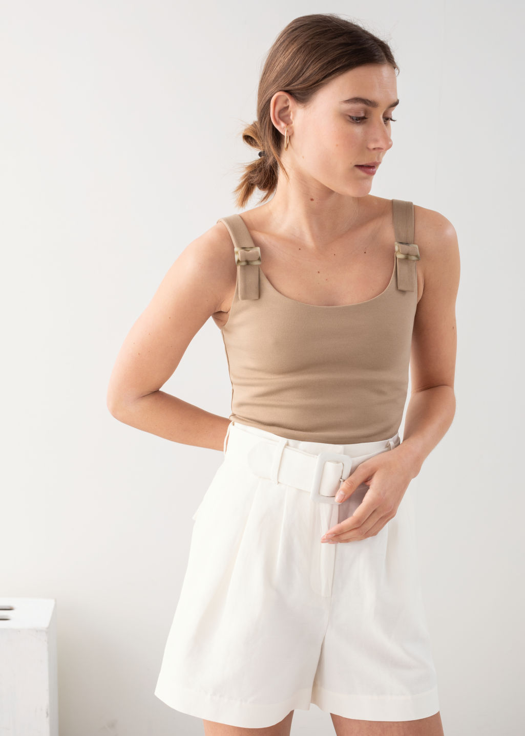 Model back image of Stories square buckle strap tank top in beige