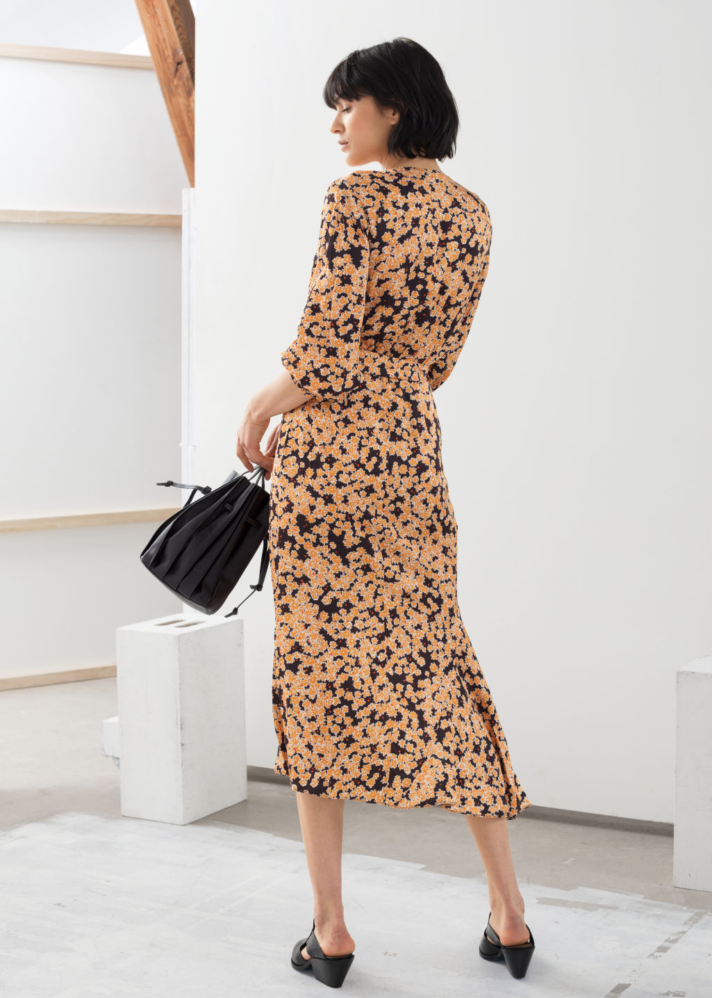 Model back image of Stories asymmetric floral midi dress in yellow