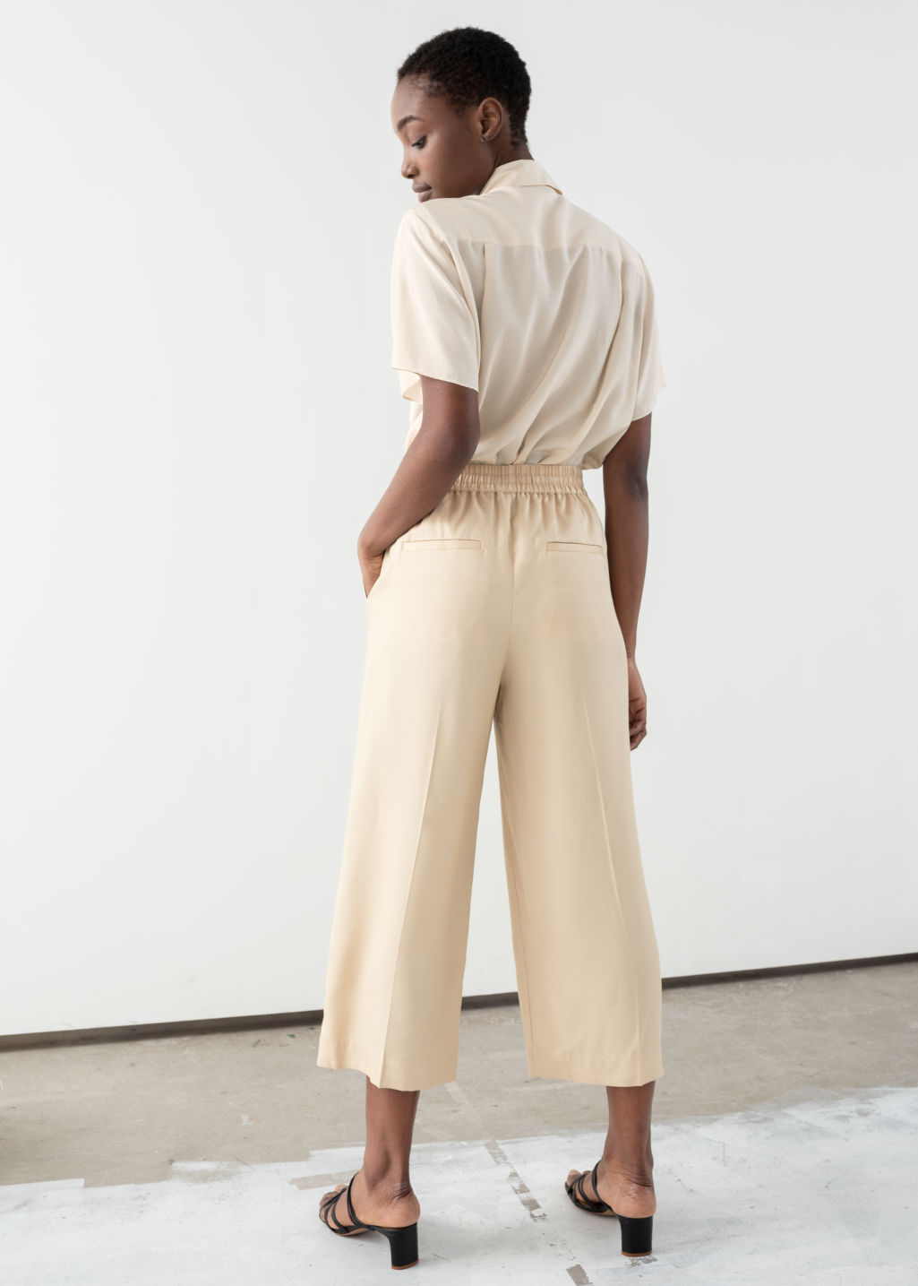 Model back image of Stories lyocell drawstring culottes in beige