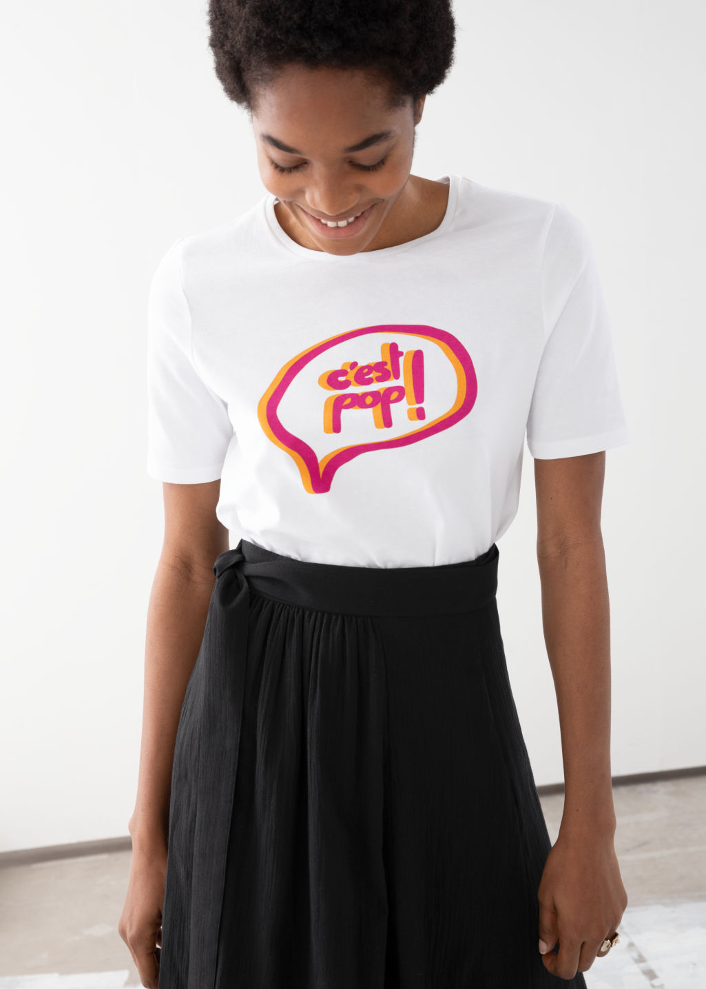 Model front image of Stories organic cotton graphic tee in white