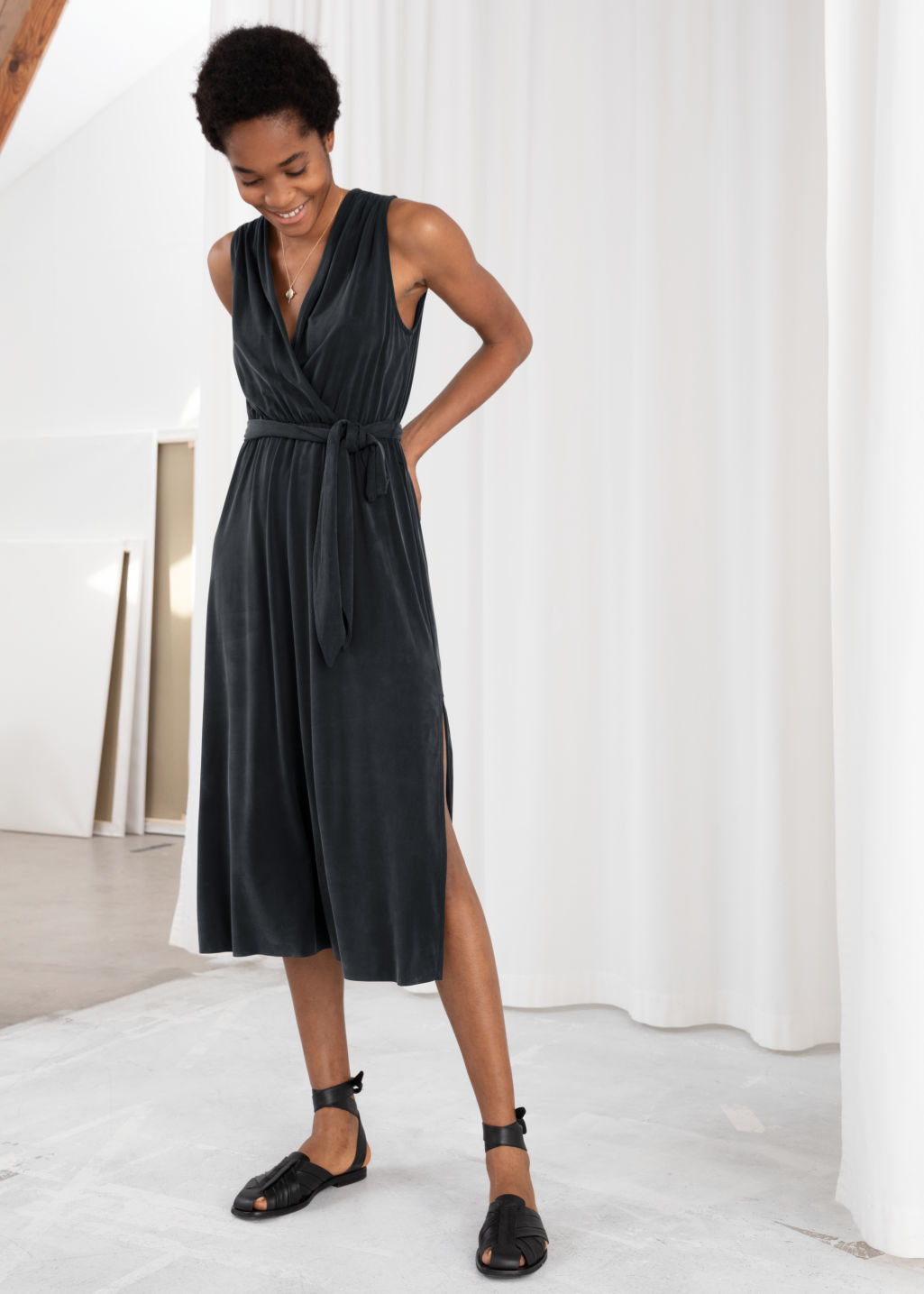 Model front image of Stories belted cupro midi dress in black
