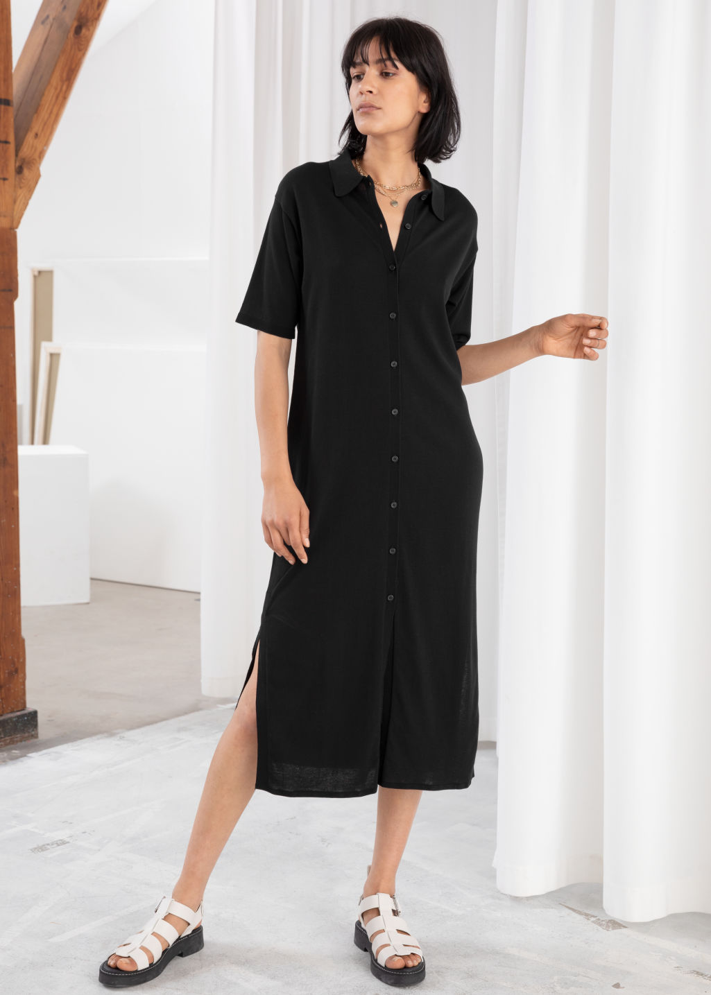 Model front image of Stories cotton blend shirt dress in black