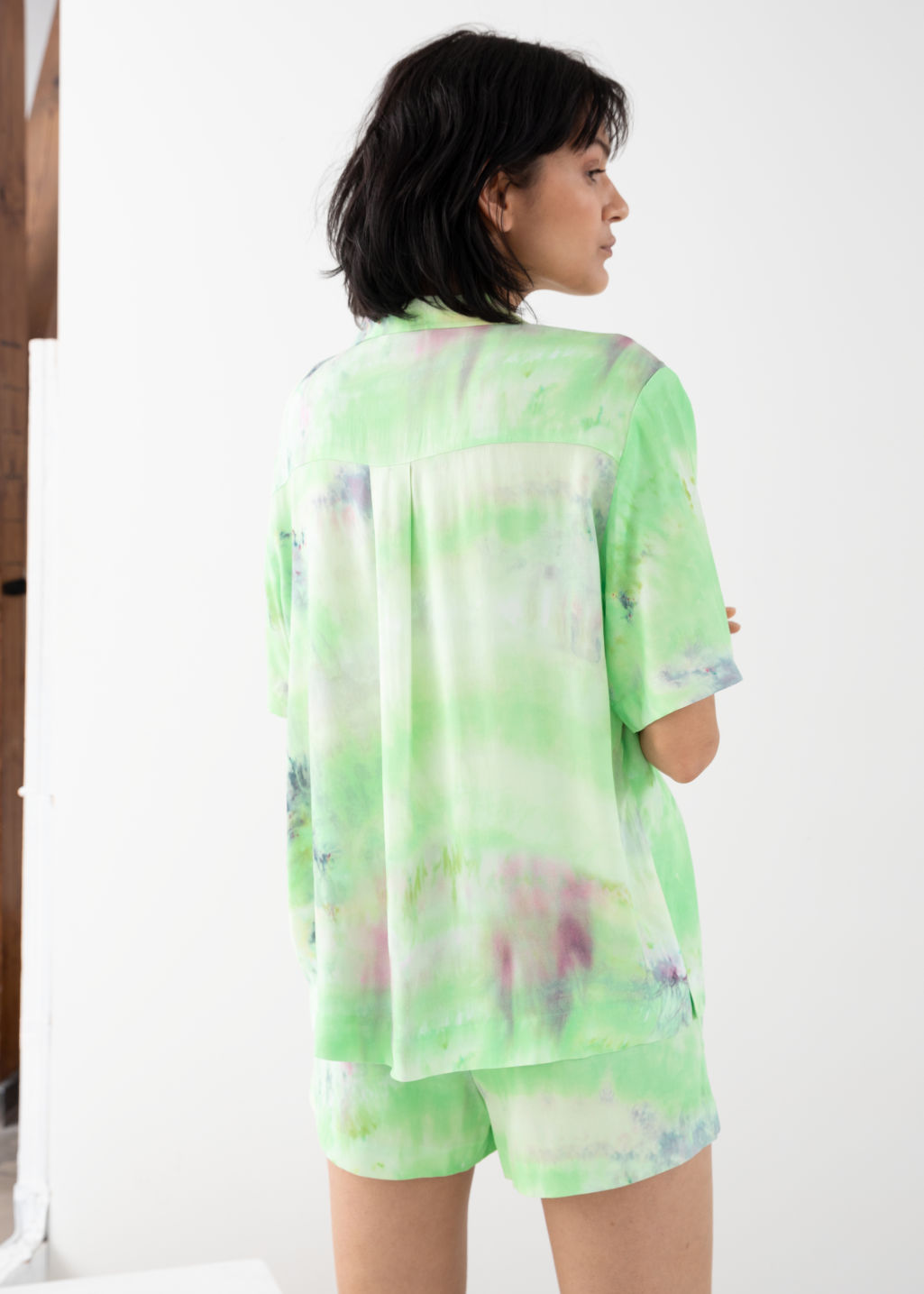 Model back image of Stories tie dye button up shirt in green