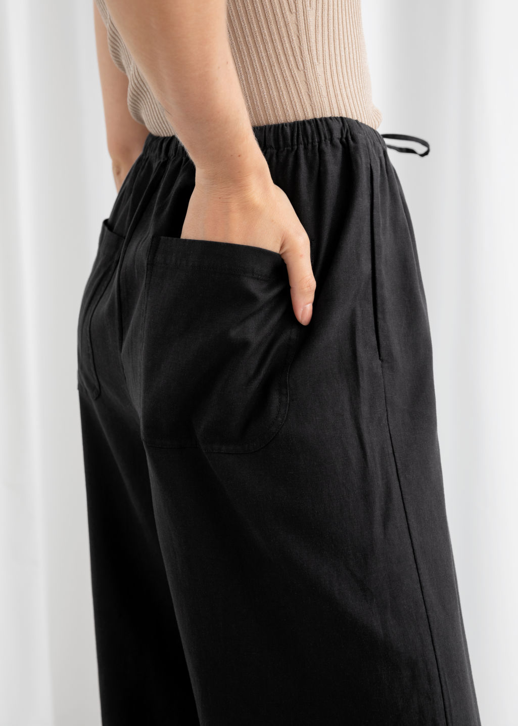 Model back image of Stories twill lyocell drawstring culottes in black