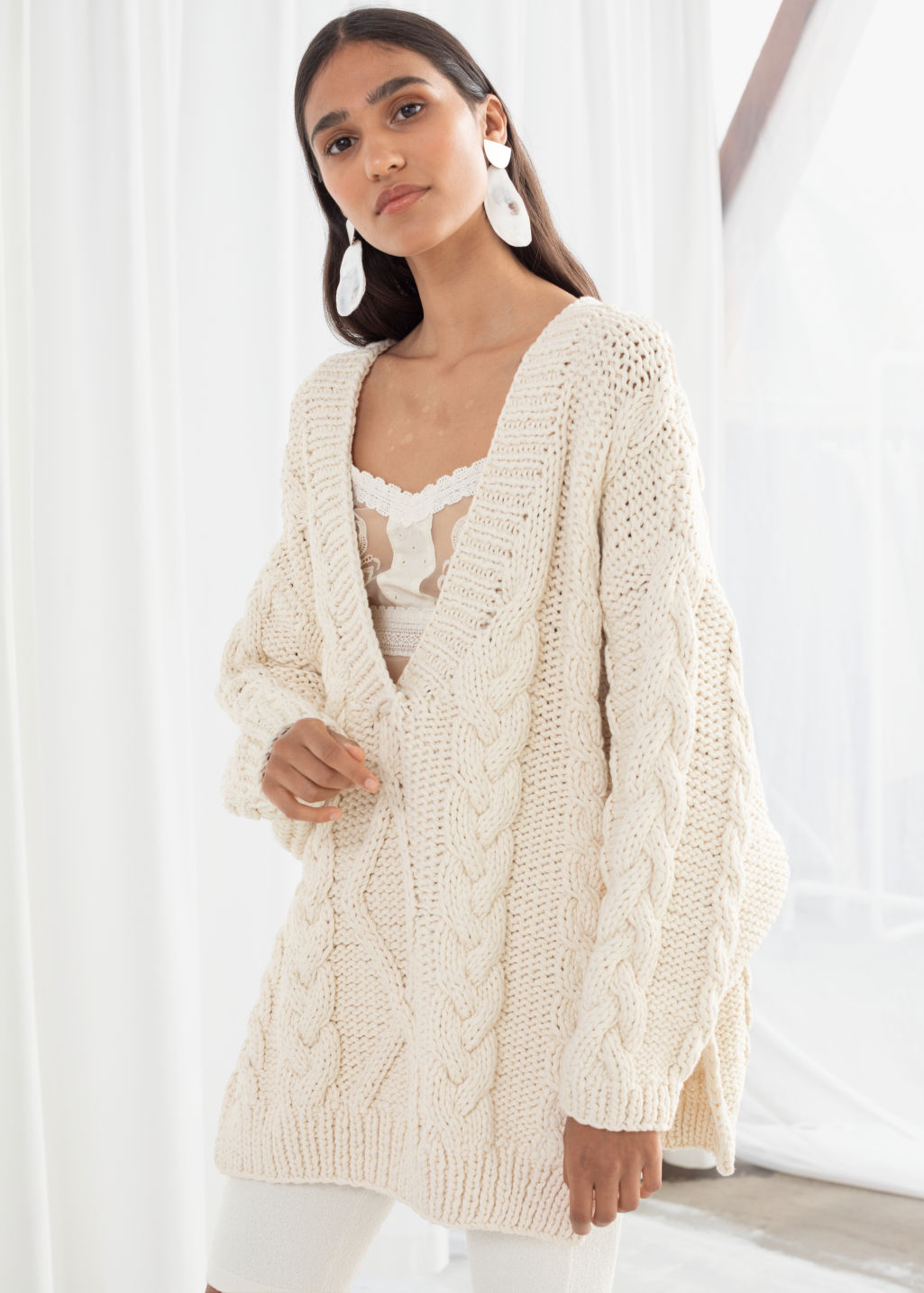 Model front image of Stories organic cotton cable knit sweater in white