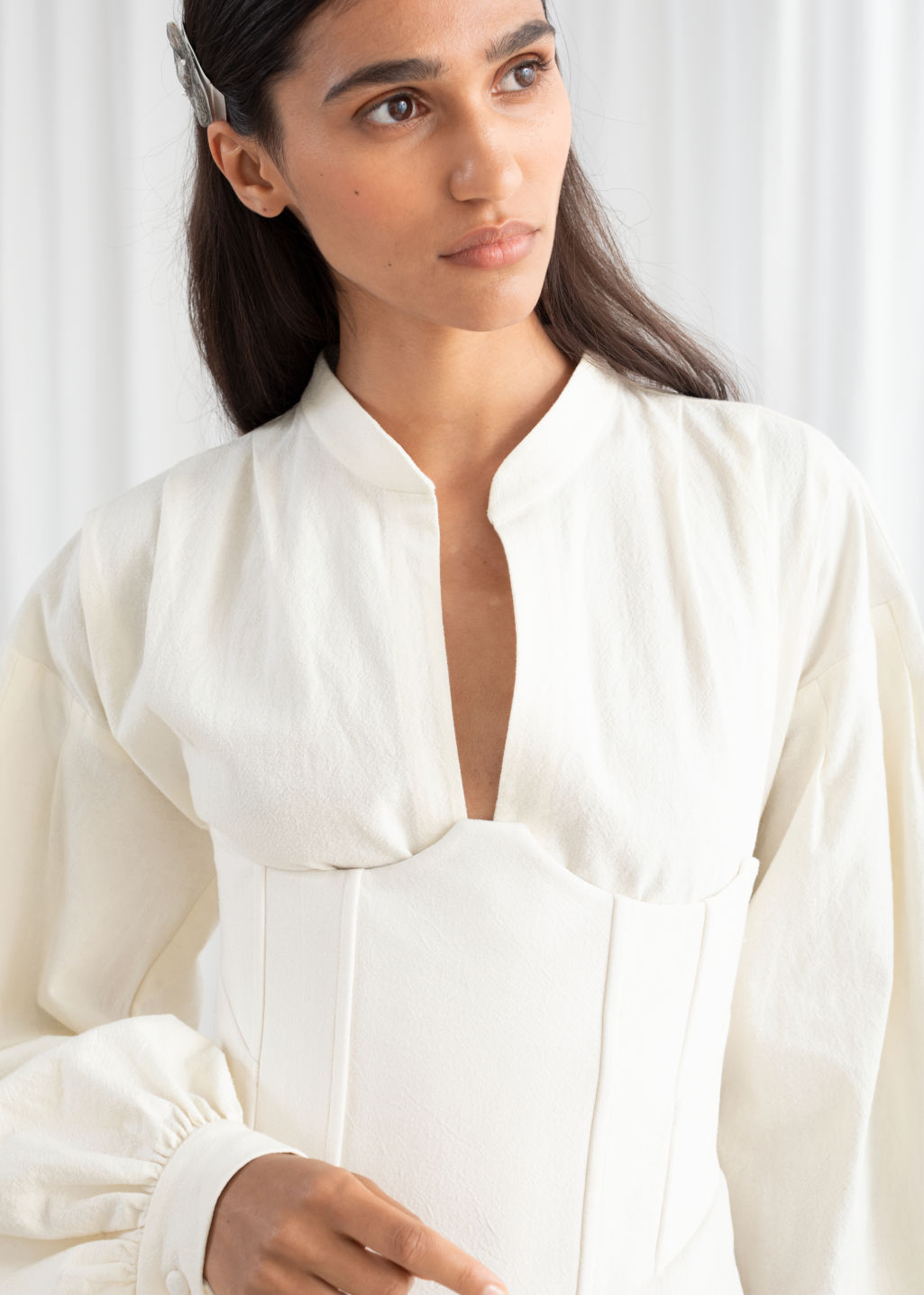 Model front image of Stories linen blend corset top in white