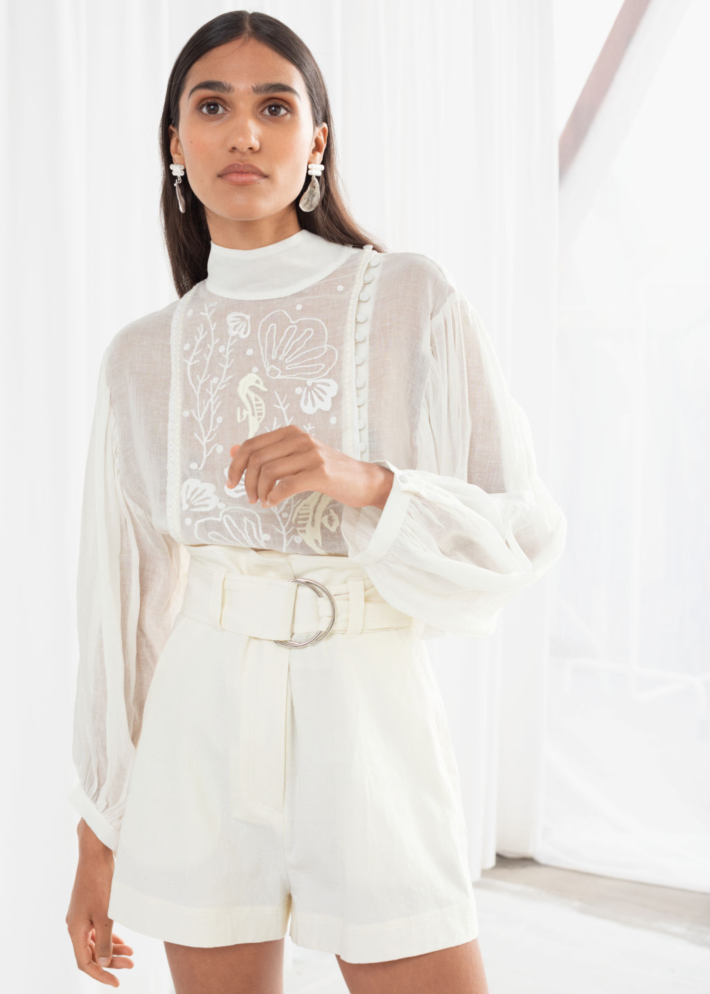 Model front image of Stories sheer embroidered linen blend blouse in white