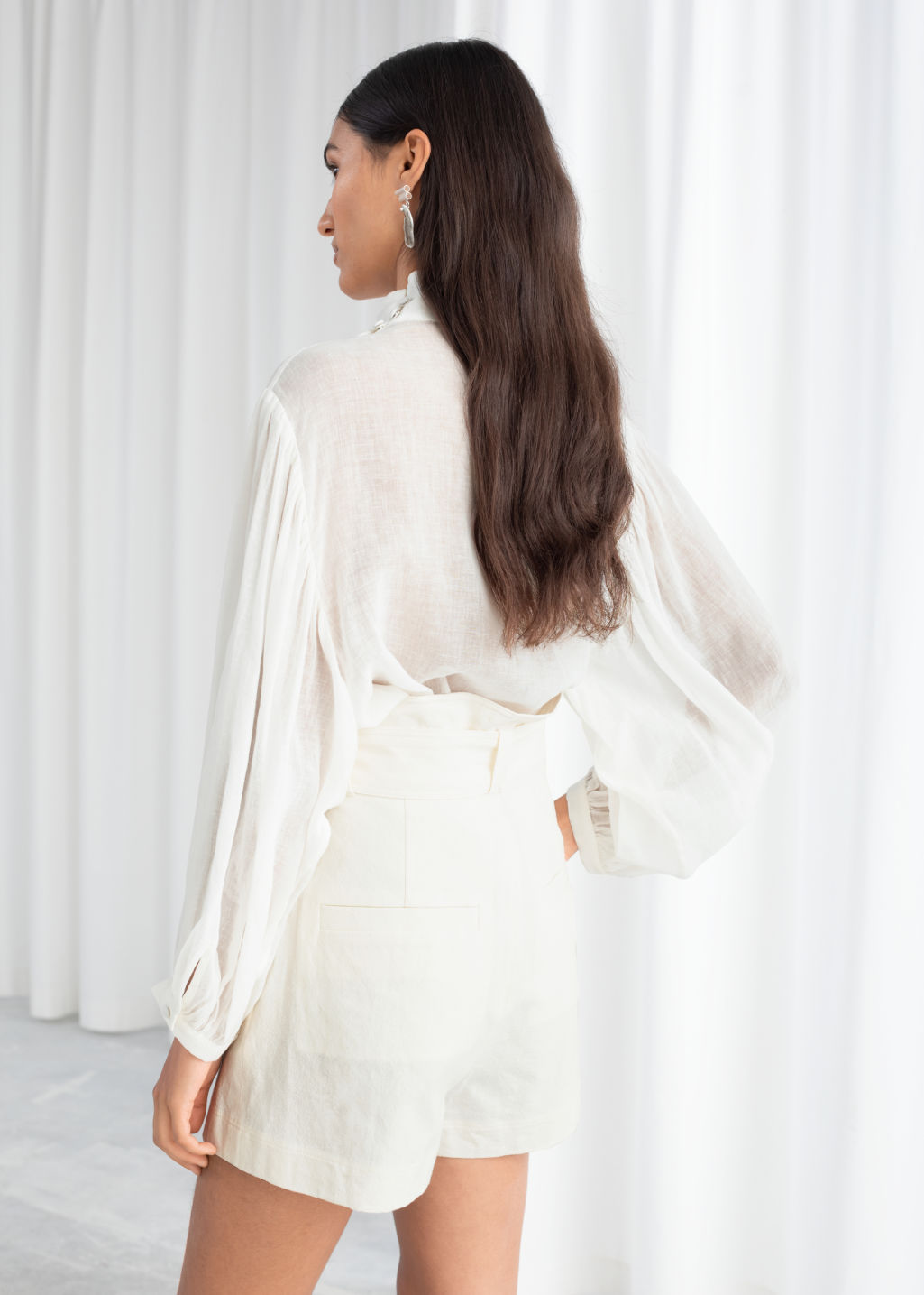 Model back image of Stories sheer embroidered linen blend blouse in white