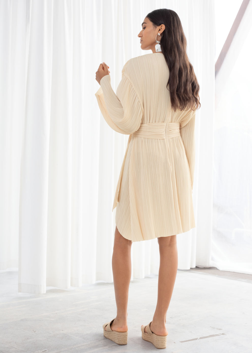 321446b6 Model back image of Stories plissé pleated recycled polyester blend dress  in beige