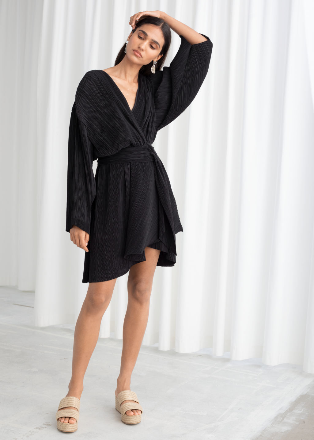Model front image of Stories plissé pleated recycled polyester blend dress in black
