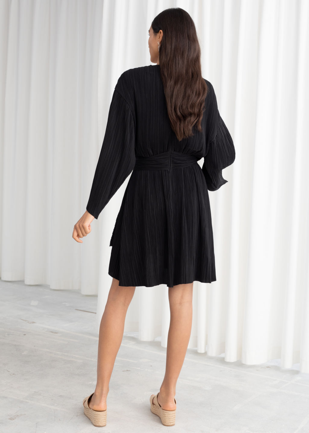 Model back image of Stories plissé pleated recycled polyester blend dress in black