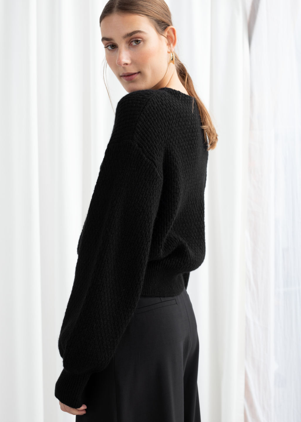 Model back image of Stories high neck cotton blend cardigan  in black