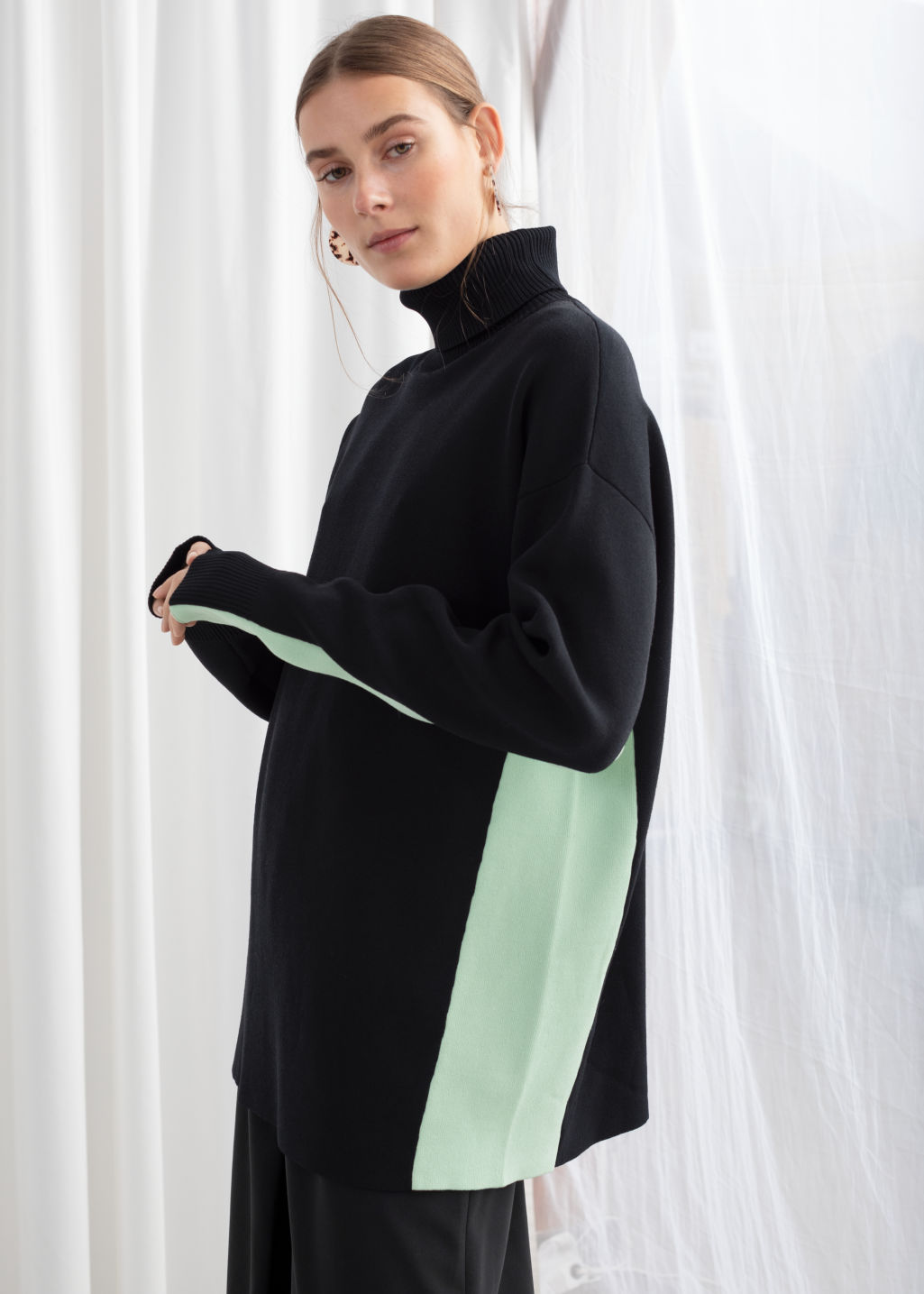 Model front image of Stories oversized side stripe turtleneck in black