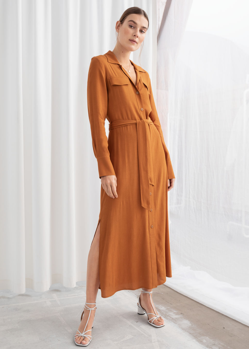 Model front image of Stories belted workwear midi dress in orange