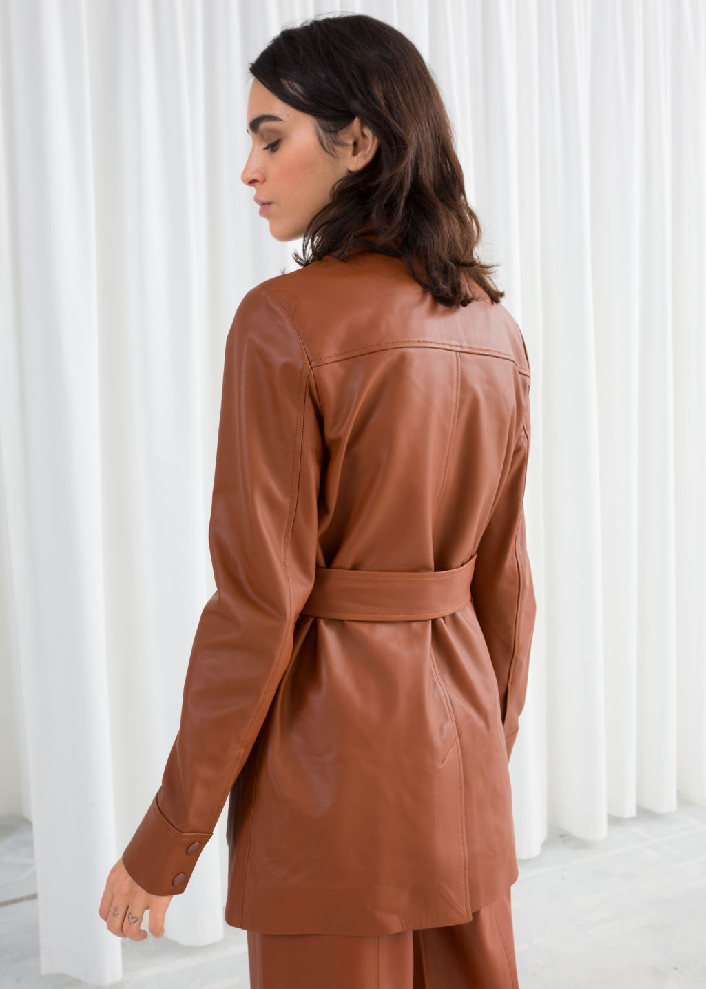 Model back image of Stories  in brown
