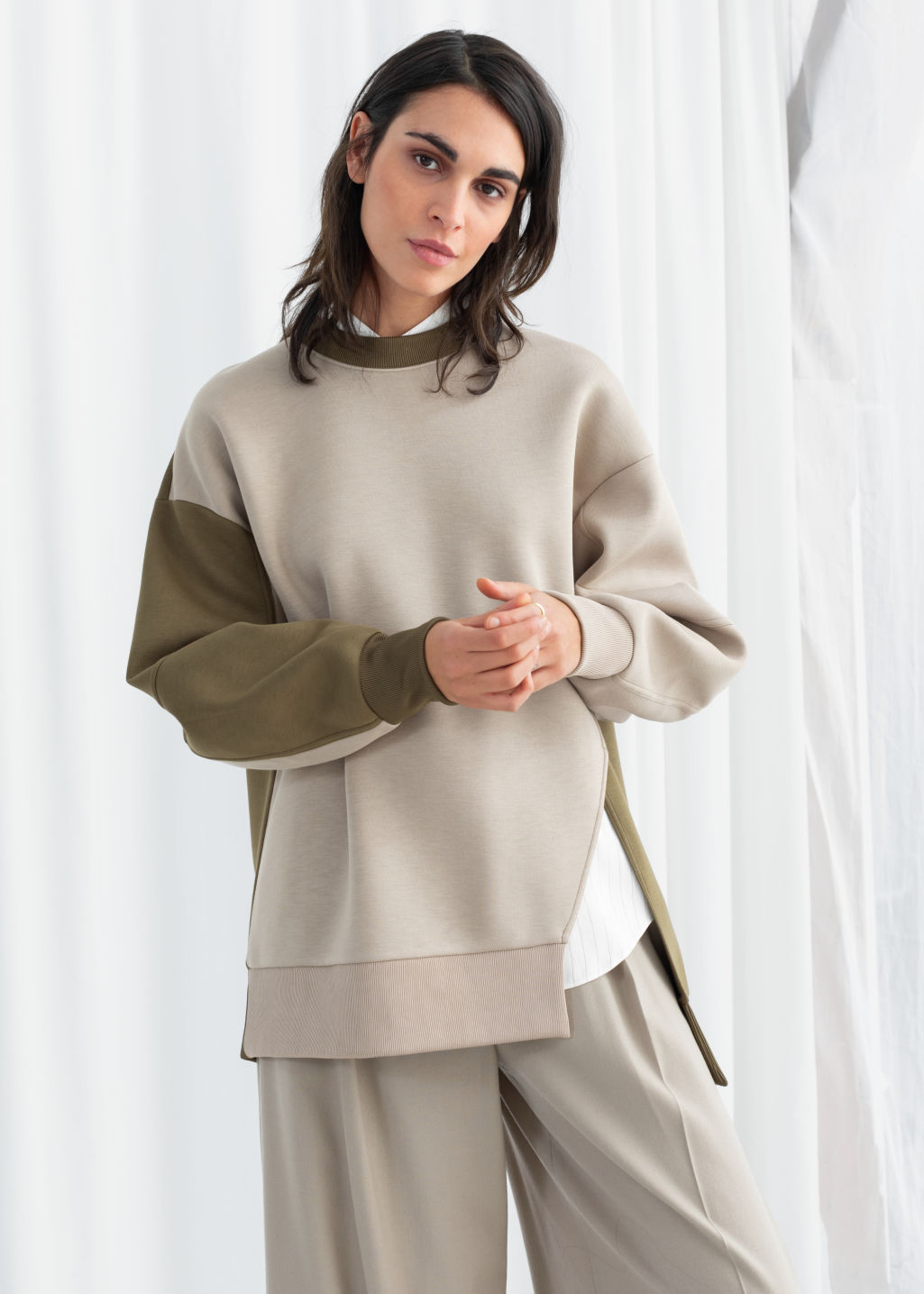 Model front image of Stories oversized patchwork pullover  in green