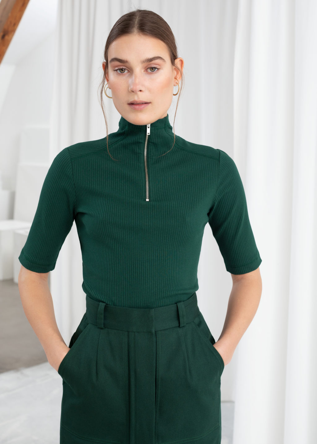 Model front image of Stories stretch cotton zippered turtleneck in green