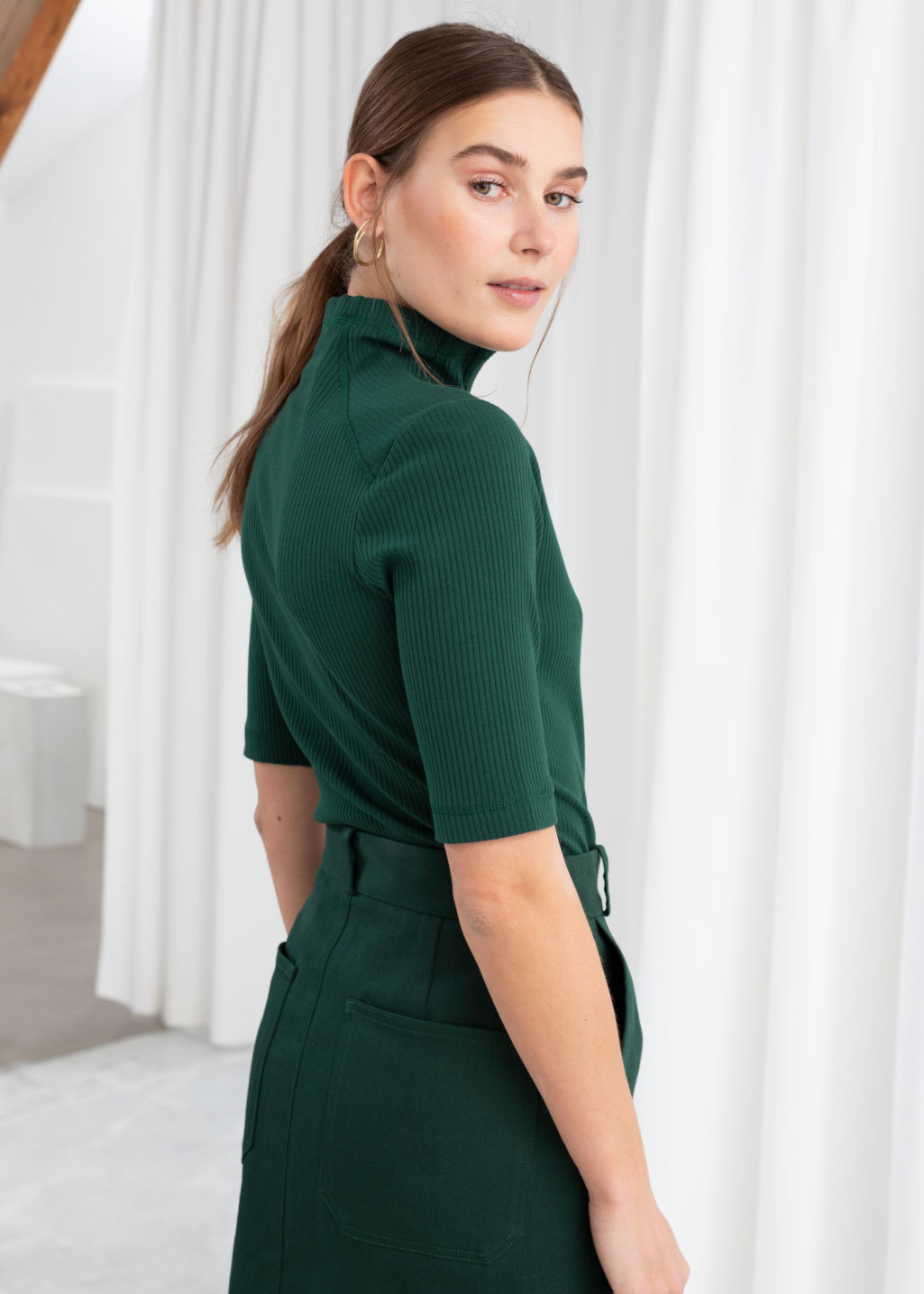 Model back image of Stories stretch cotton zippered turtleneck in green