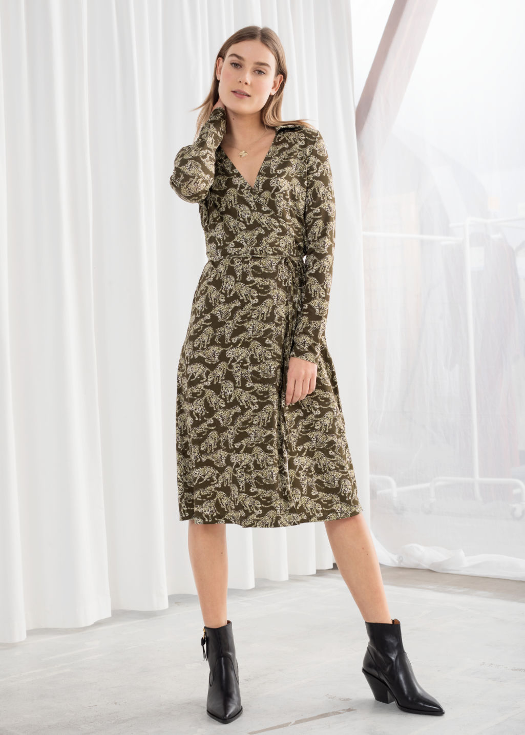 Model front image of Stories leopard print wrap midi dress in green