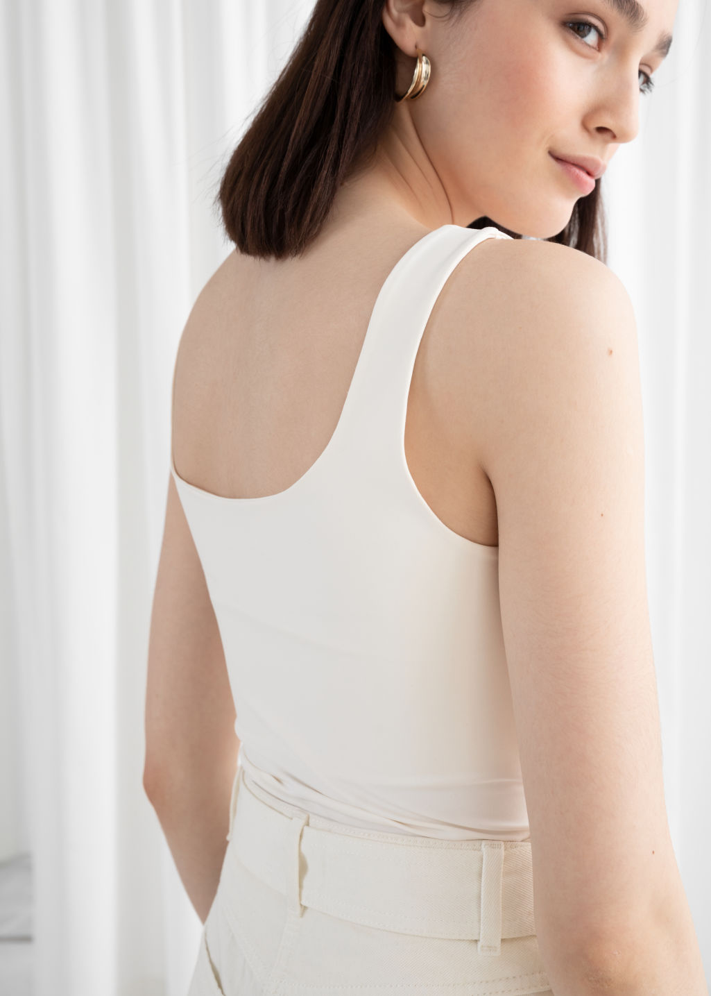 Model back image of Stories square cut tank top in white