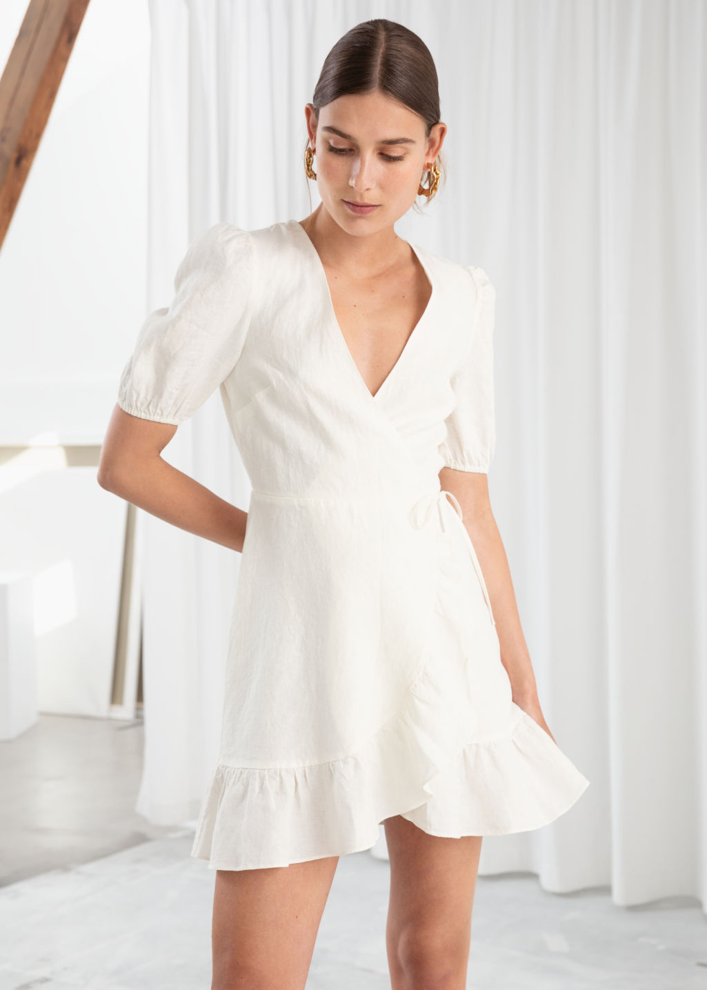 Model front image of Stories puff sleeve linen wrap mini dress in white