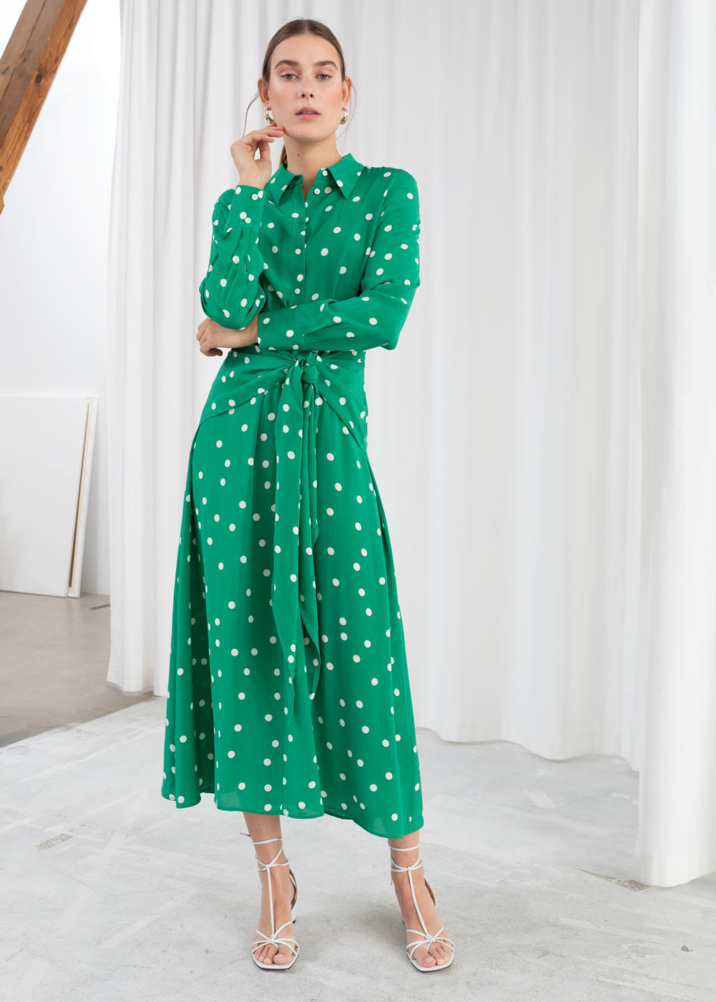 Model front image of Stories polka dot waist tie midi dress in green