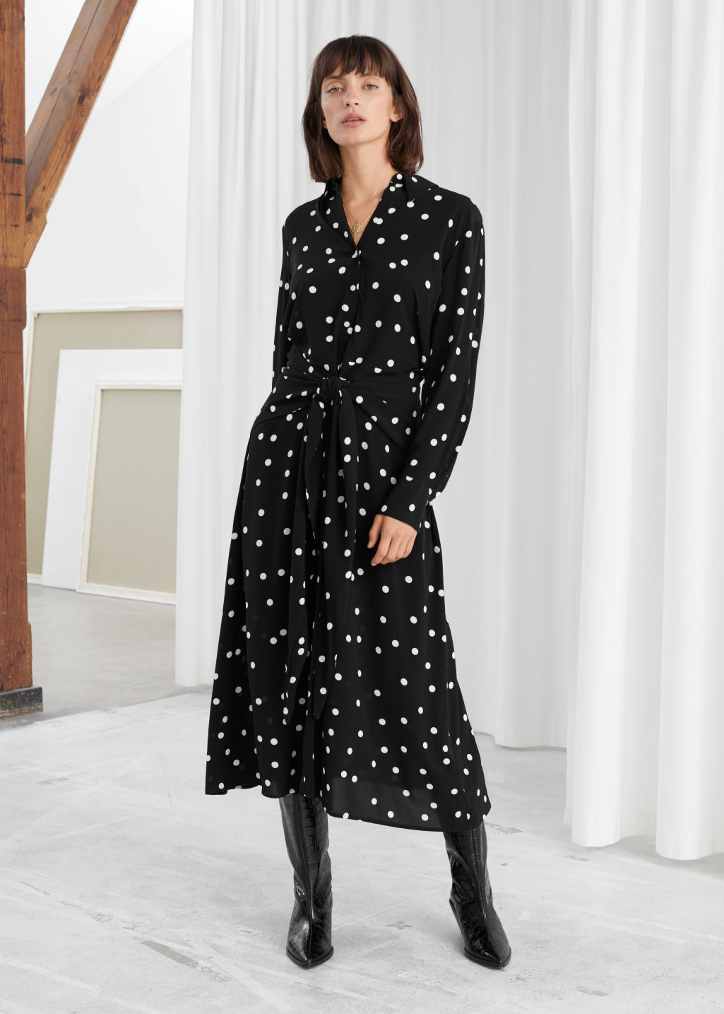 Model front image of Stories polka dot waist tie midi dress in black