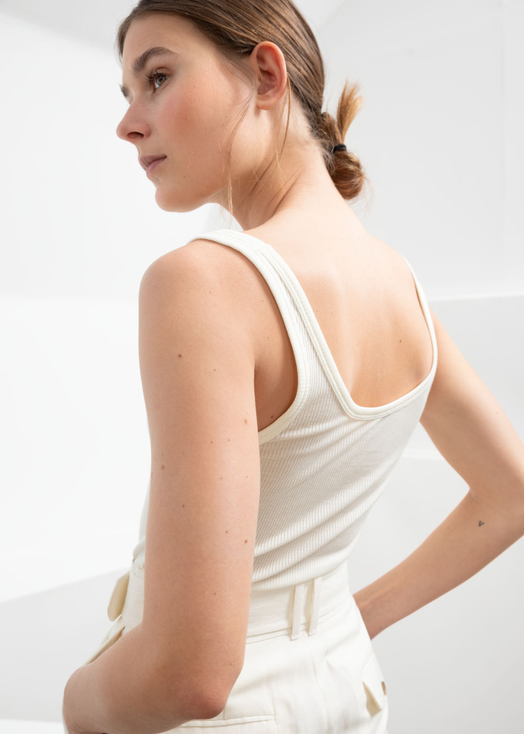 Model back image of Stories ribbed lyocell tank top in white