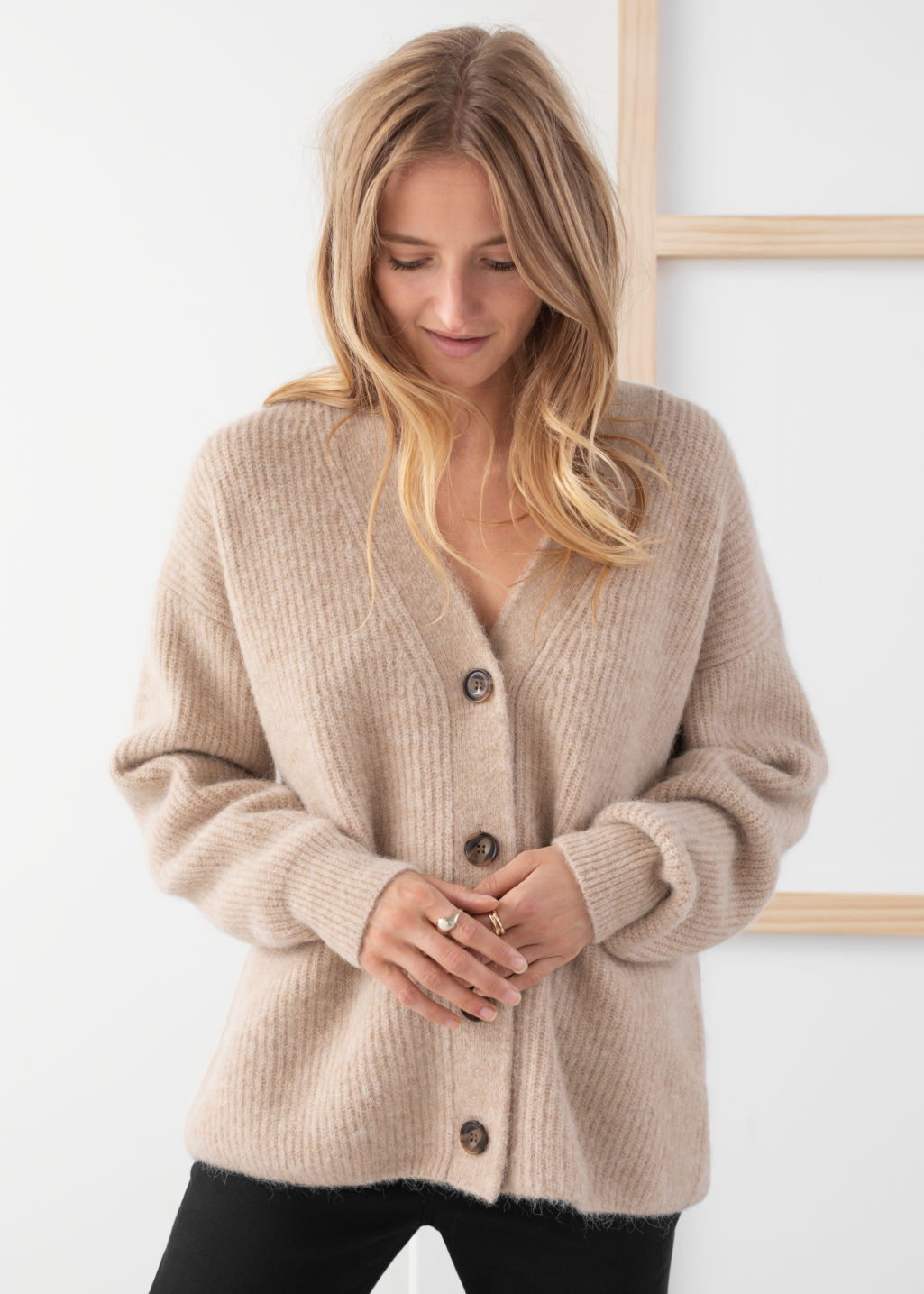Model front image of Stories oversized alpaca blend cardigan in beige
