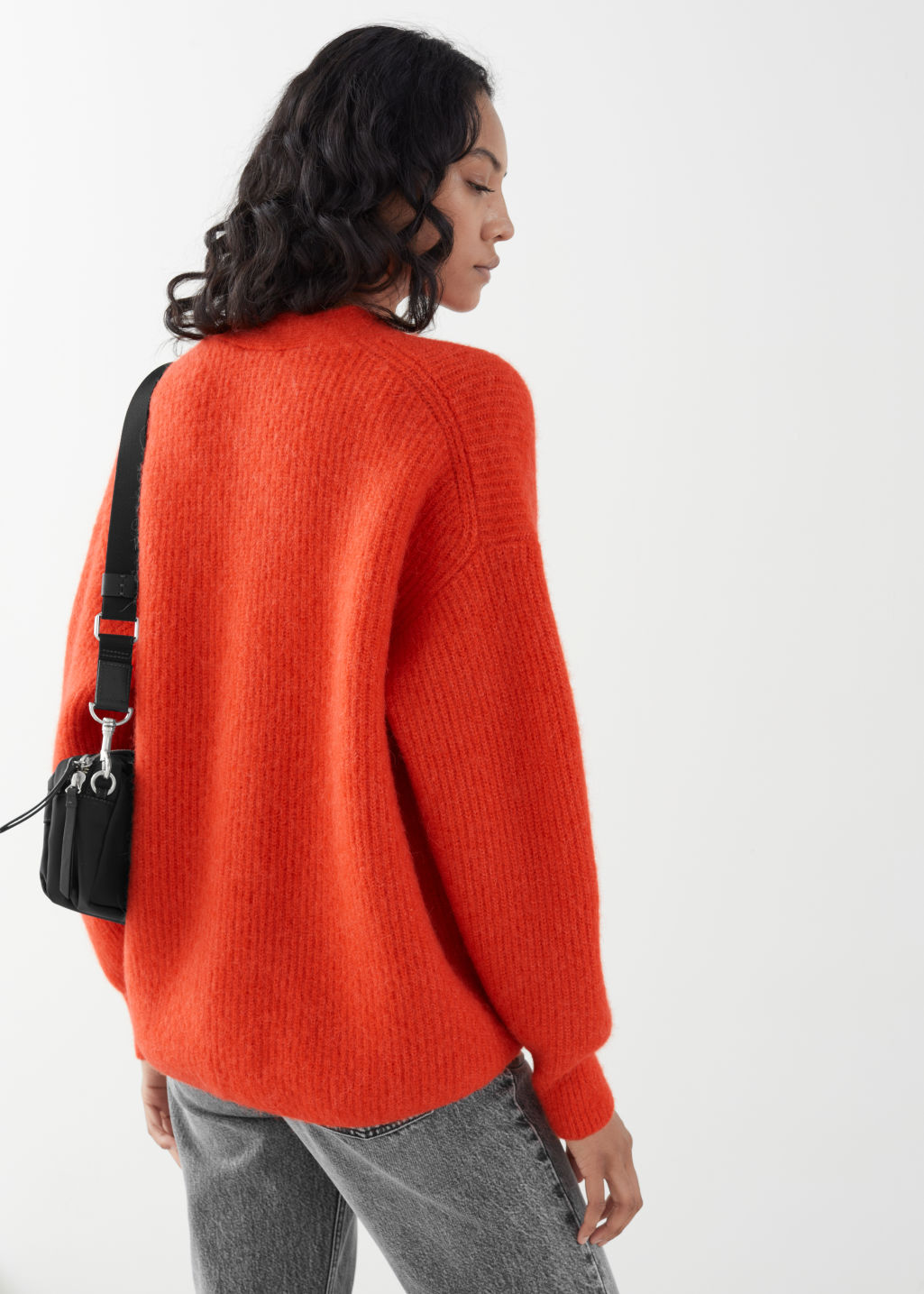 Model back image of Stories oversized alpaca blend cardigan in orange