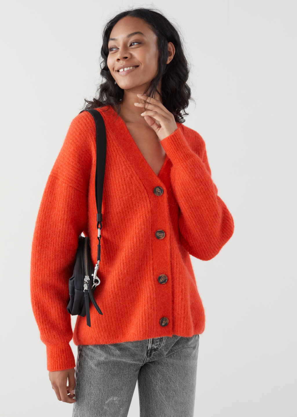 Model front image of Stories oversized alpaca blend cardigan in orange