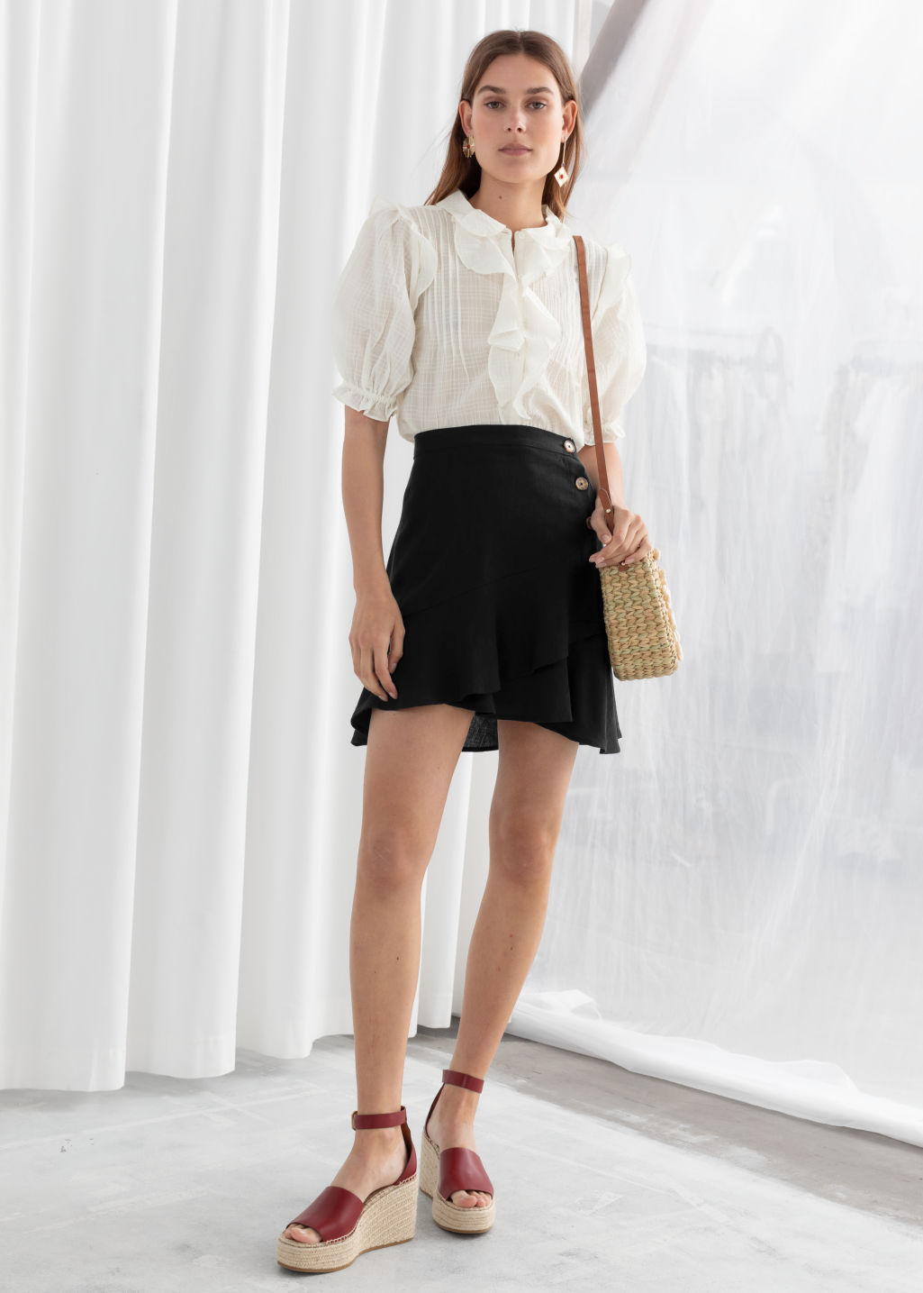 Model front image of Stories ruffled linen blend mini skirt in black