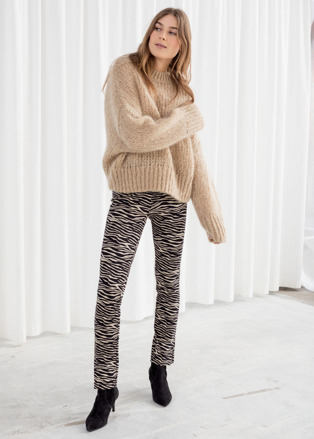 Model front image of Stories zebra print legging trousers in beige