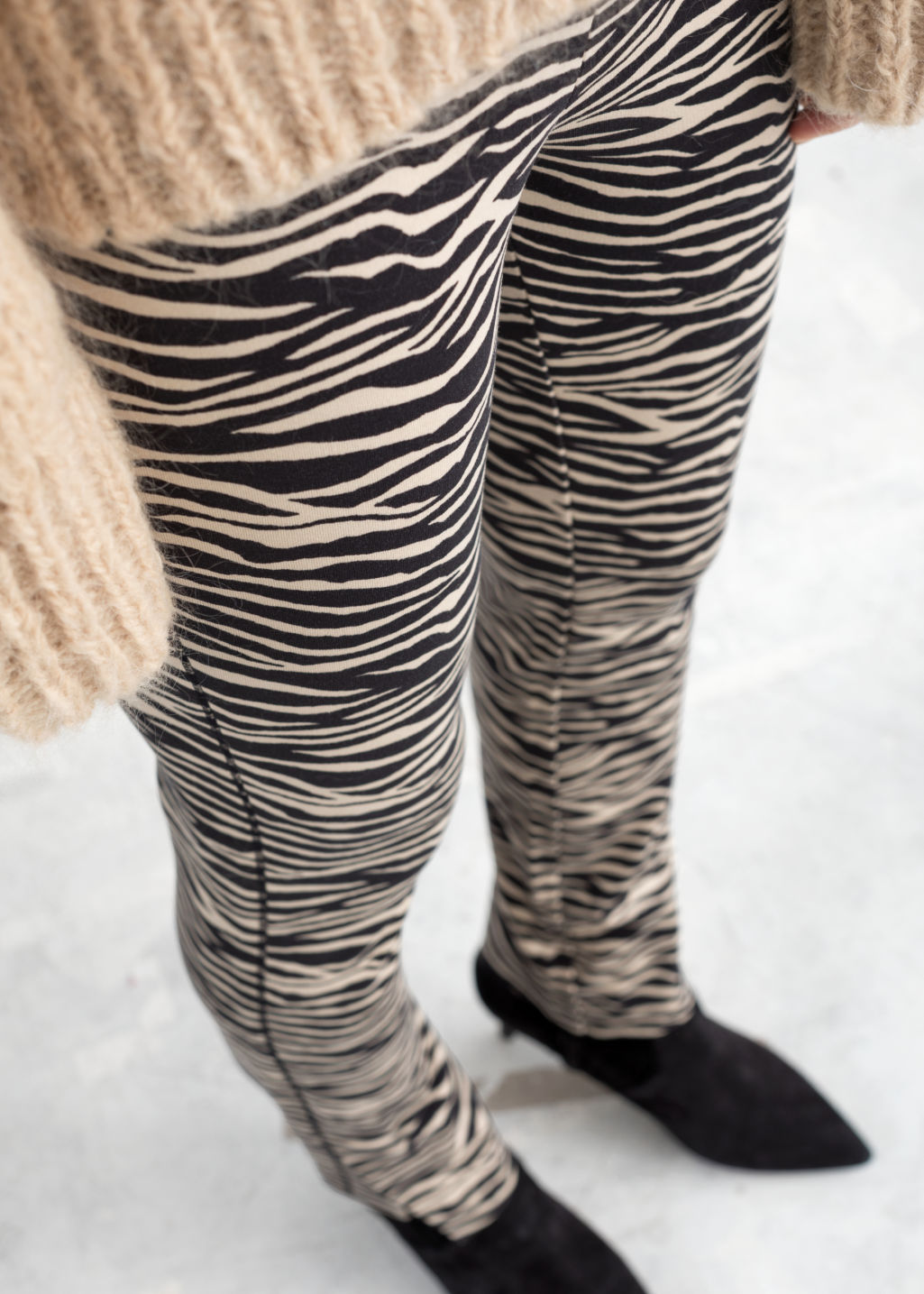 Model back image of Stories zebra print legging trousers in beige