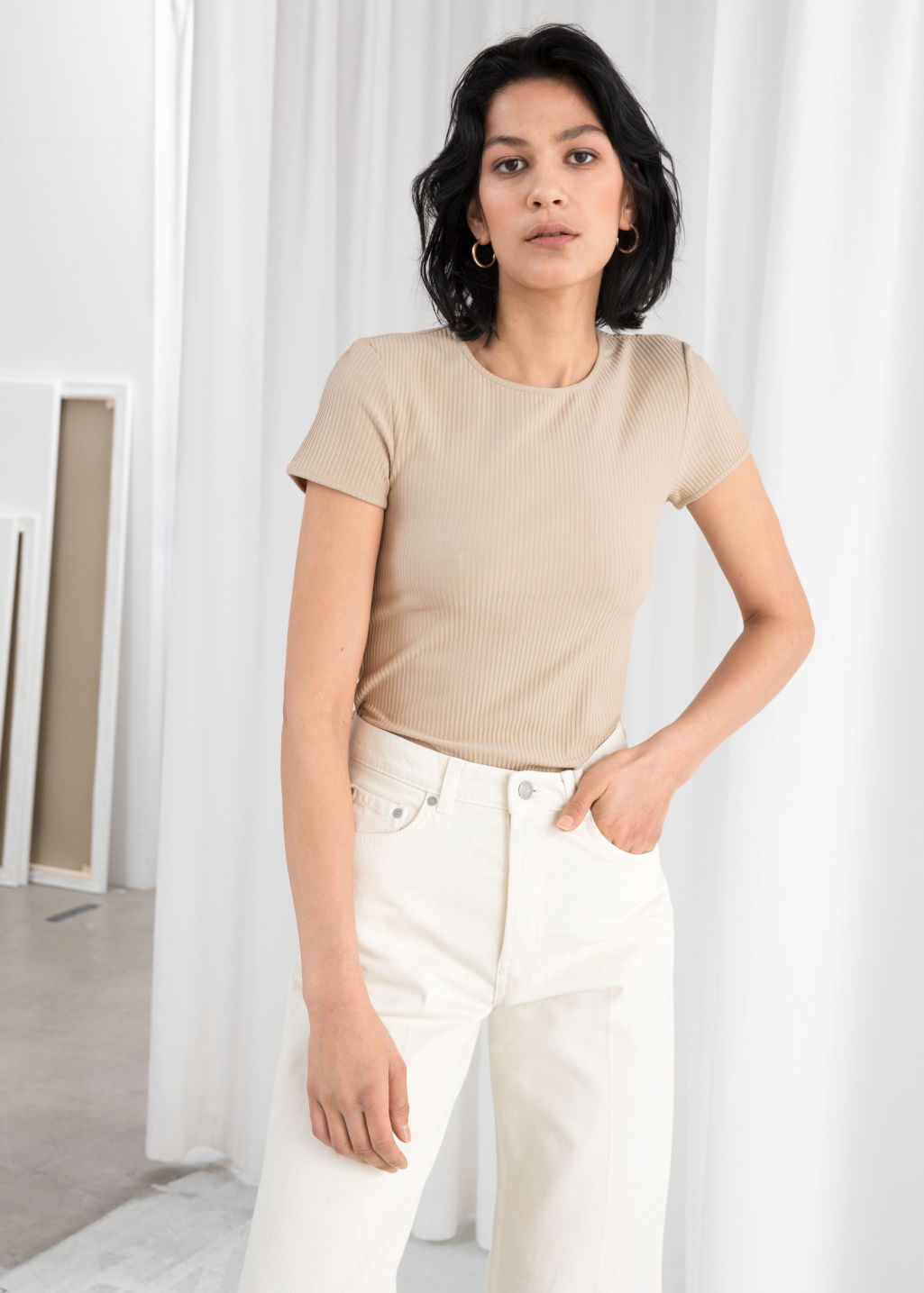 Model front image of Stories stretch cotton top in beige
