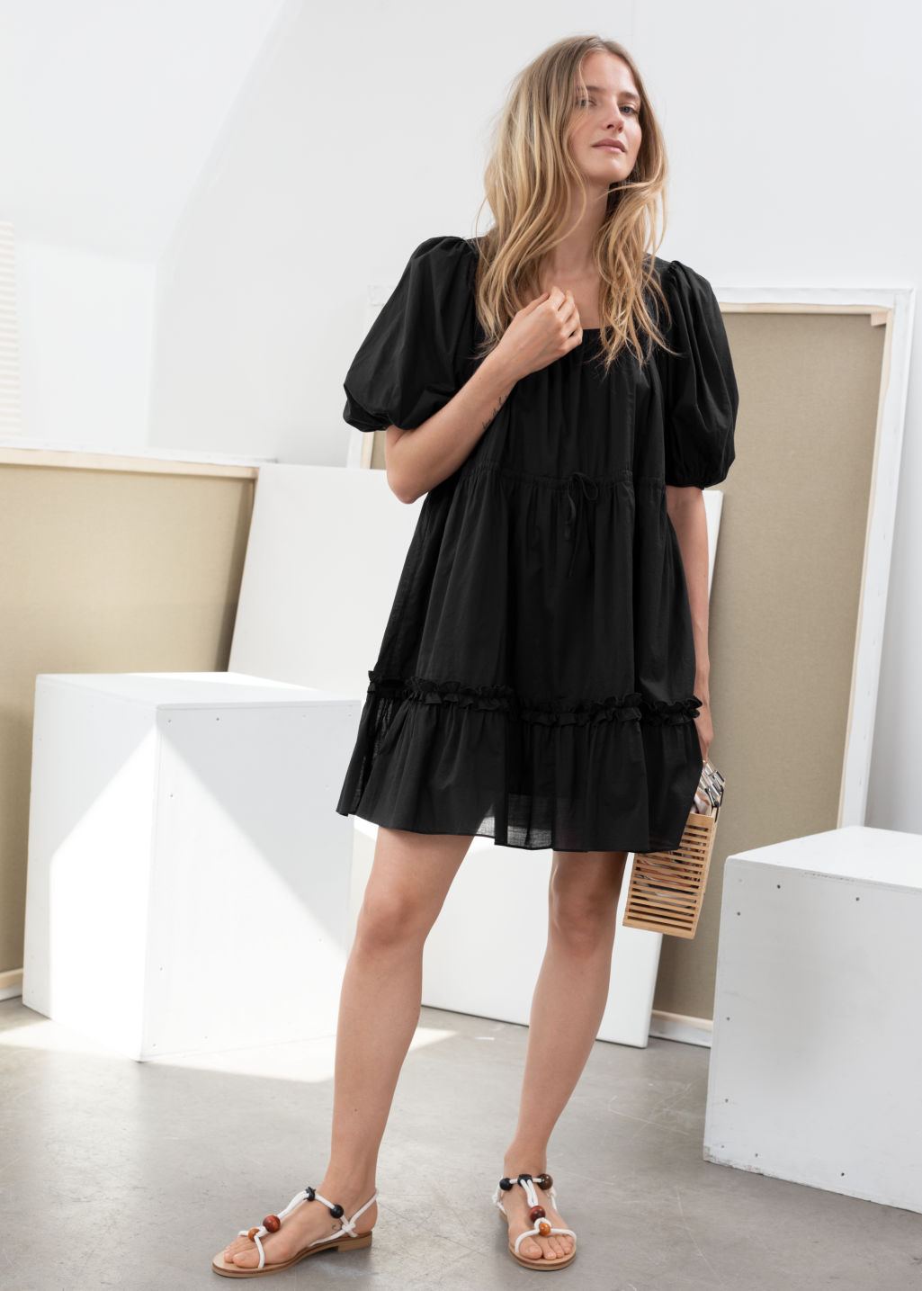 Model front image of Stories cotton puff sleeve mini dress in black
