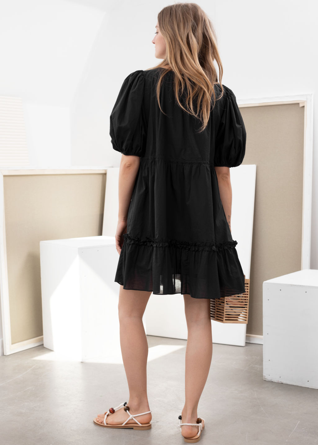 Model back image of Stories cotton puff sleeve mini dress in black