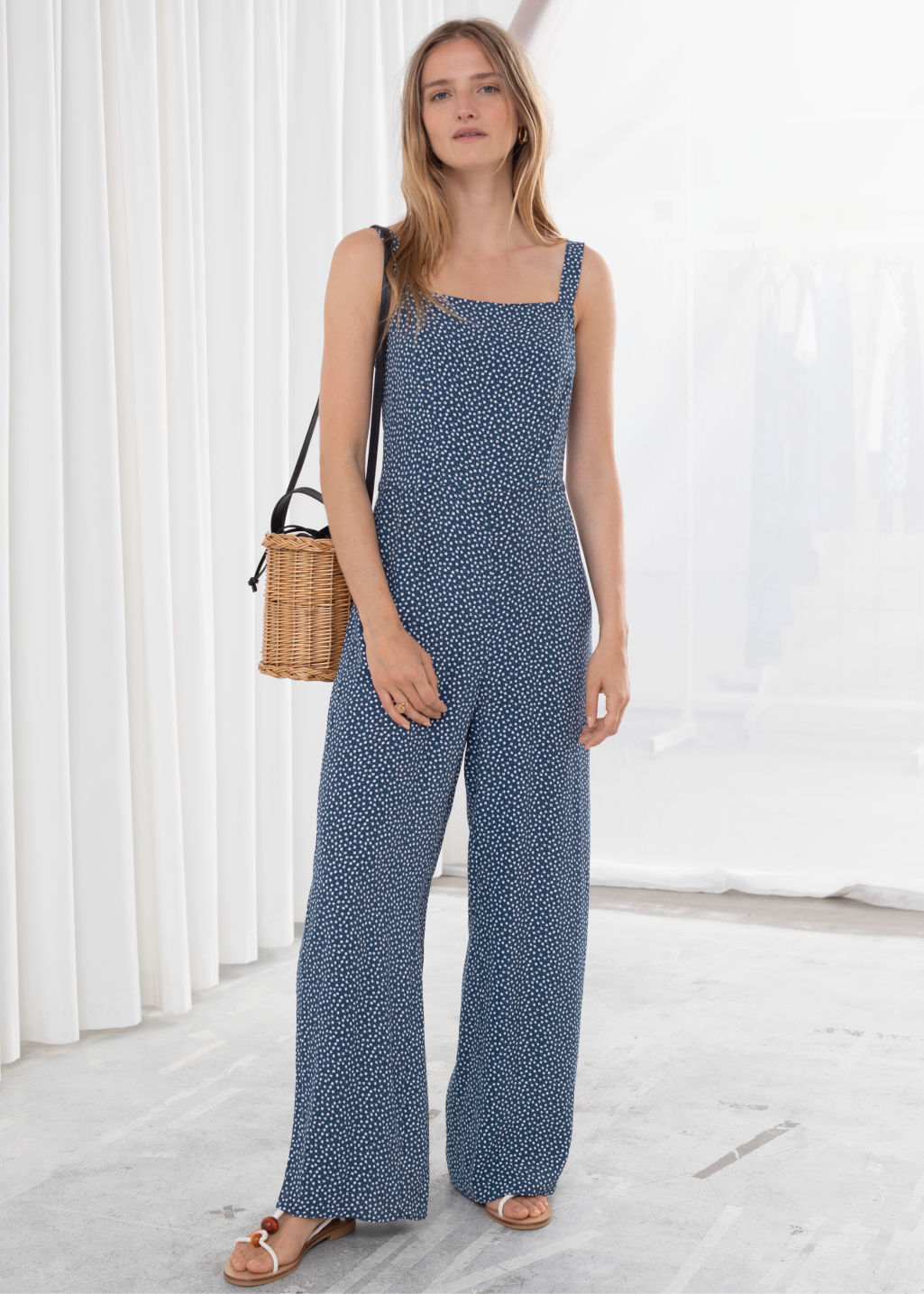 Model front image of Stories relaxed floral jumpsuit in blue