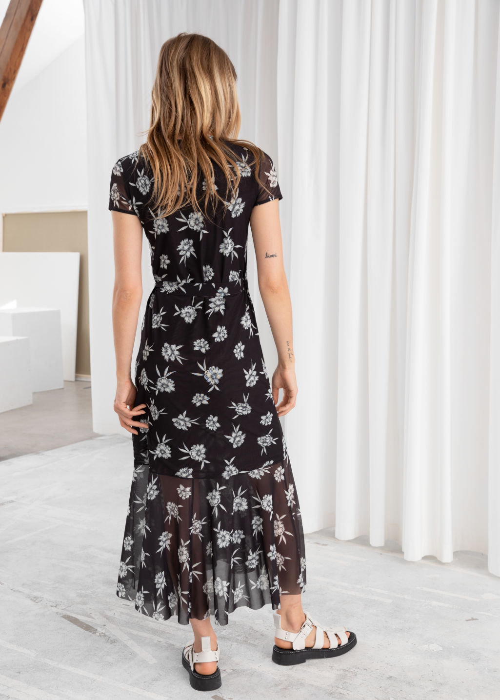 Model back image of Stories floral ruffle wrap midi dress in black
