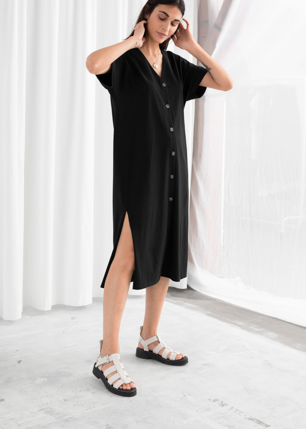 Model front image of Stories linen blend relaxed midi dress in black