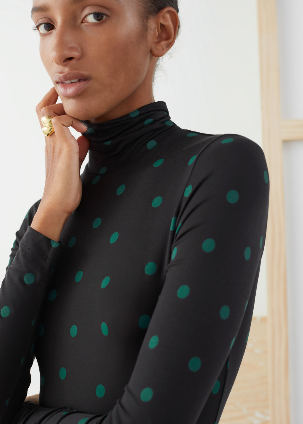 Model front image of Stories fitted stretch turtleneck top in black