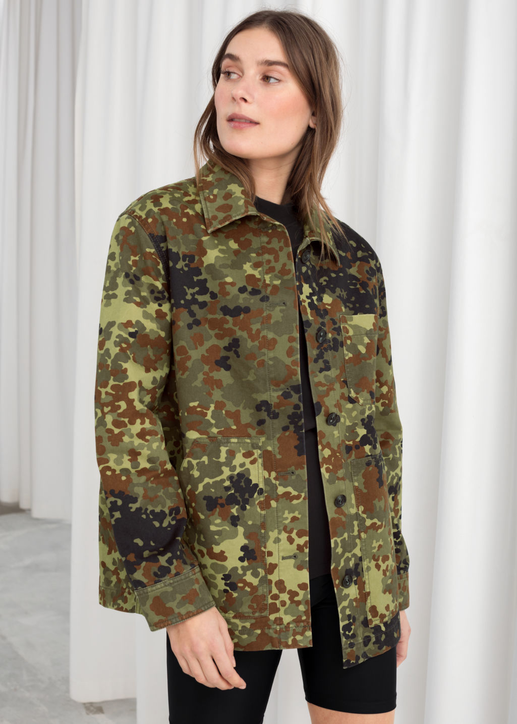 Model front image of Stories camouflage cotton workwear jacket in green